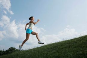 Running is a different movement than walking. It's evident that this woman is running, even in this still photograph.
