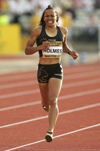 Injured British middle-distance runner Kelly Holmes struggles to finish the women's 800-meter race at the 2005 Norwich Union British Grand Prix.