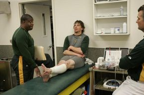 Outfielder Travis Buck of the Oakland Athletics receives treatment for his shin splints at the team's clubhouse before a 2008 game.