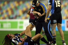 Australian rugby player A.J. Gilbert struggles to recover from a leg cramp suffered at the 2007 Australian Rugby Championships.