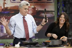 """Rachael Ray cooking with """"Tonight Show"""" host Jay Leno in 2006."""