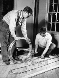 These fine gents think that radiant floor heating is a capital idea.