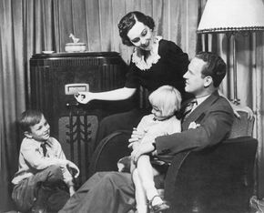 A family catches the latest serial dramas, comedies, sporting events and news on their home radio.