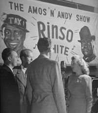 """A quartet sings during a commercial to advertise """"Amos 'n' Andy."""""""