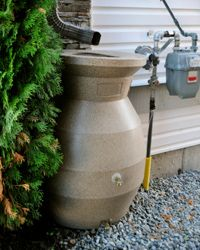 This rain barrel is a little bit fancier and a little bit more decorative; you can see the spigot where the water comes out at the bottom.