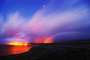A moonbow appears near dawn in Hawaii.