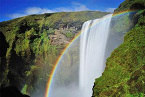 The scenic Skogafoss falls in south Iceland are enhanced with a beautiful rainbow. Why do we love rainbows so much?