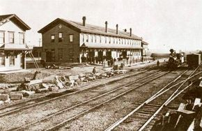 Laramie, Wyoming, grew from a small town along the railroad to a major western city. Early passengers paused at railroad hotels and eating houses such as this one for meals, rest, and perhaps a side trip to hunt buffalo.