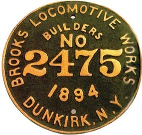 """On the flanks of almost every steam locomotive, a plaque provided the engine's pedigree. This was its """"birth certificate."""" This plaque was from the 2,475th locomotive built by the Brooks Locomotive Works."""
