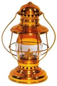 """Most hand lanterns were made of pressed steel or tinplate. A few, often called """"presentation lanterns"""" because they were retirement or promotion gifts, were of brass. Style-conscious train crews might use a fancy lantern as a snow of pride."""
