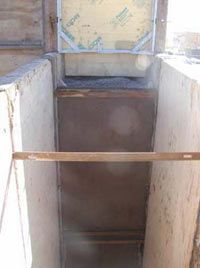 Inside the form of a rammed earth wall