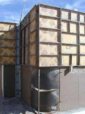 In this picture, you can see one level of completed rammed earth and the forms in place for the next level.