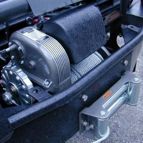 You may need an aftermarket bumper if you want to install a large winch on your truck.