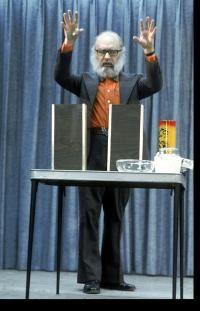 Magician and self-confessed fraud James Randi doing a magic trick.
