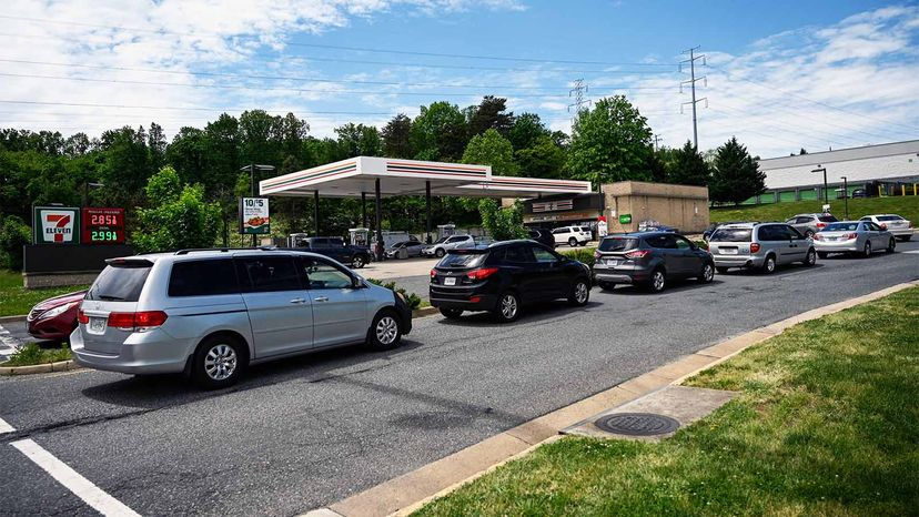 cars lined up at gas station