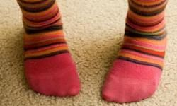 Colored socks have dyes that might further aggravate your wound -- stick with white.