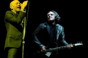 In 1996 the band R.E.M. re-signed with Warner Bros. Records for a reported $80 million, the largest recording contract in history at that point. See pictures of guitars.
