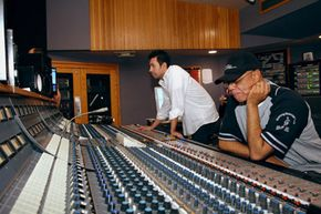 Recording engineers need an appreciation for all sorts of music. In the studio, Danny Marroquin, recording engineer for Capitol Records, left, and David Sears, senior director of education programs for the Grammy Foundation, right, record a jazz session.