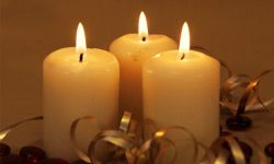 Three candles with gold ribbon and red beads , vertical