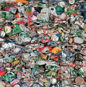 Crushed cans wait to be recycled.