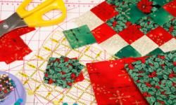 Quilting background for christmas with red, green and gold fabrics.