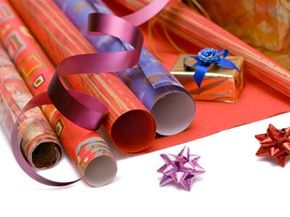 Rather than tossing the used wrapping paper at the end of a birthday party, you could save it to make bookmarks and ornaments.