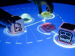 Essential Gadgets Image Gallery The reactable is a new music synthesizer that works by placing, moving and arranging blocks on top of a table to generate different sounds. See more pictures of gadgets.
