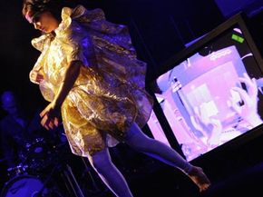 """Icelandic singer Björk performs at the Sydney Opera House in Sydney, Australia, during her world tour in support of her album """"Volta."""" If you look closely at the video screen in the photo, the image is of a DJ tweaking blocks on the reactable."""
