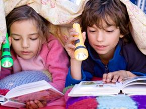 Young readers and their trusty flashlights