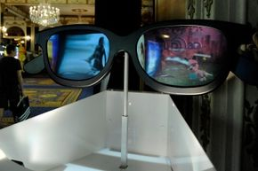 Not for actual use: A huge pair of RealD 3-D glasses on display at ShoWest in 2010.