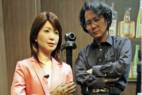 Hiroshi Ishiguro with an early version of his Repliee android at the Prototype Robot Exhibition at the 2005 World Exposition in Nagakute, Japan