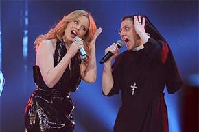Sister Cristina, a Roman Catholic nun, sings a duet with Kylie Minogue on the Italian version of 'The Voice.' Sister Cristina won the singing contest in 2014 but did not quit her day job.
