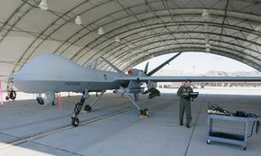 Air Force Maj. Casey Tidgewell gets an MQ-0 Reaper ready for a training flight at Creech Air Force Base in Indian Springs, Nev. The Reaper has a long line of UAV predecessors.
