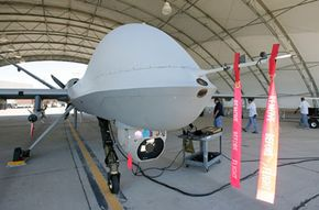 Mechanics get a Reaper ready for a training flight at Creech Air Force Base.