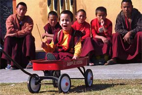 American Buddhist monk, Sonam Wangdu, renamed Trulku-la, is unhappily pulled along at a monastery in Katmandu in 1996. The 4-year-old was believed to be the reincarnation of the high lama Deshung Rinpoche III, who died in 1987.