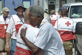 A Hurricane Katrina victim gets a hug from a Red Cross worker at the St. Agnes service center in Houston, Texas.