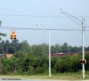 Multiple cameras are mounted high above the intersection to get a full view of any traffic violators. See more car safety pictures.