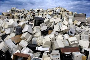 Used televisions and computer monitors pile up at a recycling center in Norway. Americans junked almost 3 million tons of electronics in 2006.