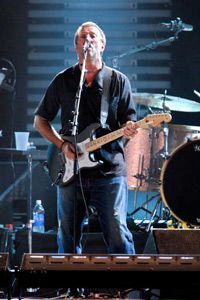 Eric Clapton, a and substance abuser, performs a benefit concert for the treatment facility he founded, Crossroads Centre.