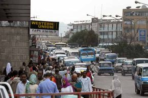 People walk past a Western Union office in Addis Ababa, Ethiopia. Western Union is so popular for remittances that agencies use its money transfer statistics to track the global movement of migrant labor.