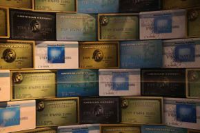 Credit cards fill a window display at American Express headquarters in New York City. American Express actually started out as a package delivery service.