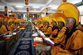 Buddhist nuns pray for their spiritual leader.