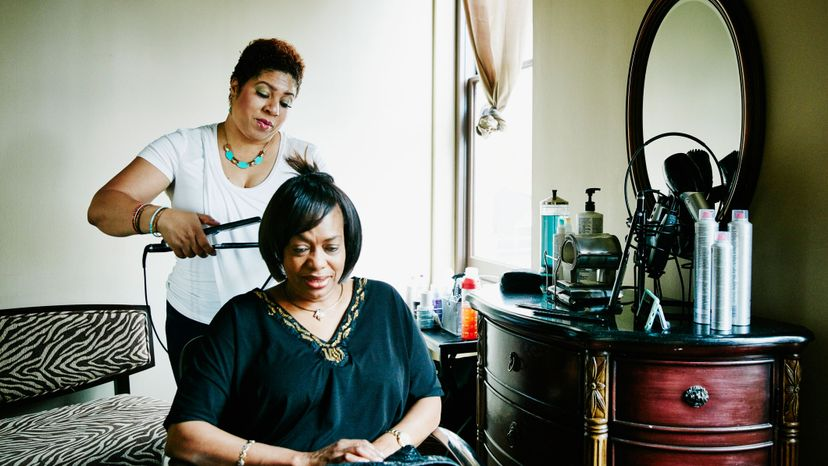 black woman getting flat iron