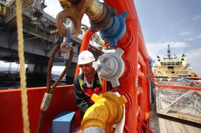 A worker turns a valve to transfer fuel to the equipment drilling a relief well in the Gulf of Mexico in May 2010.