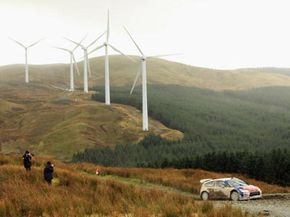 Dani Sordo drives past a wind farm during the Wales Rally GB in Llangurig, Wales.