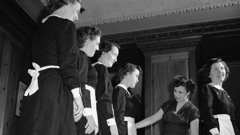 A restaurant manager inspects her staff's uniforms in the 1940s. Bettman/Getty Images