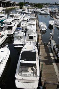 Repossessed boats sit in the marina of National Liquidators in Fort Lauderdale, Florida.