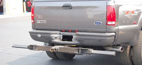 The stinger arm on this stealth repo truck folds up to look like a trailer hitch. It's actually part of the telescoping towing apparatus mounted beneath the truck.