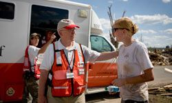 Red Cross volunteers fly across the United States and overseas to provide assistance to residents affected by all types of disasters.