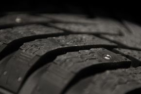 With a press of a button, the driver can bring out the studs to improve the grip of the tire.